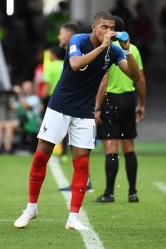 France s forward Kylian Mbappe drinks water during the Russia 2018 World Cup  round of 16 football match between France and Argentina at the Kazan. 3ea75cd50