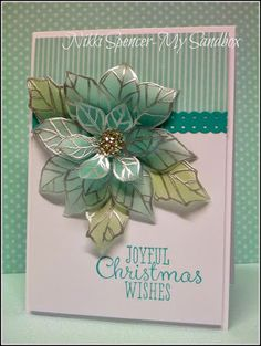 handmade Christmas card ... poinsettia embossed with silver, colored on the back, cut out, attached in curving layers ... beautiful! ...Stampin' Up!