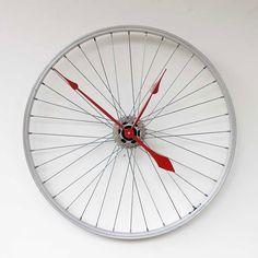 Beautiful and lightweight reused bike wheel into clock.
