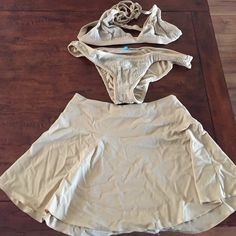 BCBG MAXAZRIA SWIM with skirt cover-up Tan and gold 3 piece BCBG swim with a short skirt cover up in a size 10. Halter top has 2 different sizes for waist strap. BCBGMaxAzria Swim Bikinis