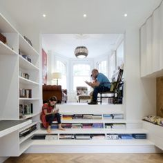 Zminkowska De Boise inserts combined  bookshelf-staircase into London flat