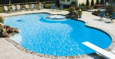 Stone coping gives this free form pool a natural yet sophisticated presence.
