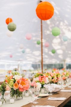 Low rows of coral charm peonies etc. Tented Reception -- Beautiful! See more on #SMP: http://www.StyleMePretty.com/2014/05/09/marion-summer-waterfront-wedding - Joyelle West Photography - jwestwedding.com