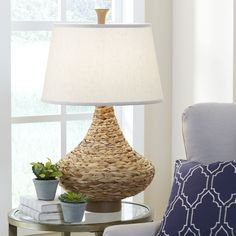 Miramar Table Lamp | Tightly woven seagrass around an exaggerated vase silhouette offers texture and warmth to the look of the Miramar Table Lamp.