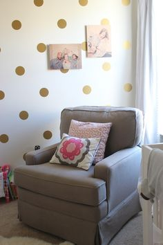 Gold polka dot decals from Urban Walls in Amara's toddler room, love & lion