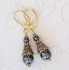 Beaded cone earrings.