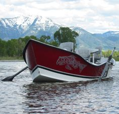 A pair of black filament wound composite Cataract Oars float aside this drift boat on the river. Cataract Oars are the oar of choice for the serious drift boat fly fisherman or angler. #cataractoars #extremeoars #fishing #flyfishing #drift #driftboat #driftboating #driftoars #driftboatoars #fishingoars #whitewaterfishing #dory #doryoars www.cataractoars.com www.advancedcomposites.com