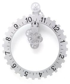 Kikkerland Big Wheel Revolving Wall Clock Kikkerland http://www.amazon.com/dp/B000CDVYNW/ref=cm_sw_r_pi_dp_losJtb11WKJRAGSR