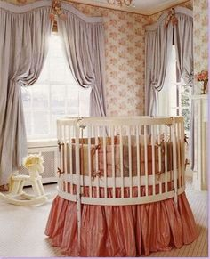 Nursery by Suellen Gregory. It avoids many cliche' ideas about using pink in a nursery. By using a peachy-pink combined with gray, she achieved a very sophisticated look that could grow with the little girl.