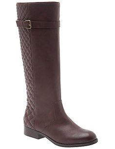 Timeless riding boot gets a fresh face with equestrian-inspired quilted details. Fit for wide width, wide calf comfort with an adjustable buckle and stretchy gored panel. Side zipper for easy entry. lanebryant.com