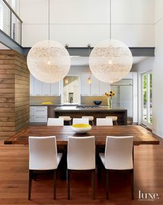 Modern White Dining Room with Spherical Light Fixtures