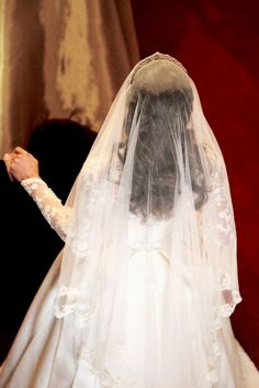 A back view of Kate Middleton's wedding veil as she approaches Prince William at Westminster Abbey on the arm of her father, Michael Middleton on her wedding day, April 29, 2011.