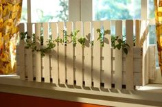 Picket Fence Planter Made From Paint Stir Sticks