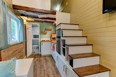 Kitchen storage built into the staircase.