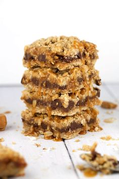 Coconut Caramel Chocolate Bars - A decadent and irresistible recipe made with a crispy oatmeal cookie crust. A dessert that is easy to make and even tastier to eat! | jessicagavin.com