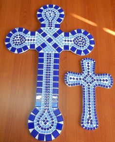 These two crosses - extra large and medium in size - were made with light and dark blue crystal glass tiles. I used white grout which I tinted with blue acrylic paint.