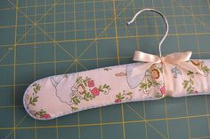 Padded Coat Hanger Tutorial I have been making these coat hangers to give as gifts, and they really are simply quite lovely. Padded Coat Hangers, Wooden Coat Hangers, Baby Clothes Hangers, Shabby Chic Fabric, Clothing Hacks, Clothing Websites, Coordinating Fabrics, Easy Sewing Projects, Crafty Craft