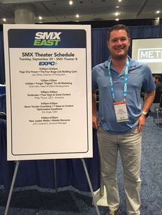 """John proudly posing next to the poster announcing his presentation at SMX, titled """"Mobile Moments."""" Click the photo to see the rest of our photos from SMX East 2015."""