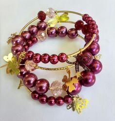 Mod:P73 pulsera de perlas de cristal con dijes en chapa de oro $99.00 mayoreo 25% de descuento $74