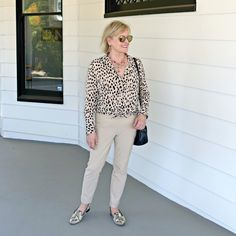 Jennifer Connolly of A Well Styled Life wearing cheetah shirt and sand pants in a casual look from Chico's