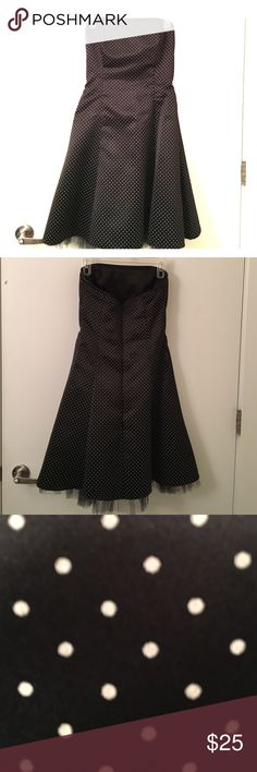 Jessica McClintock knee length strapless dress Beautiful knee length strapless black dress with light pink polka dots. Great for a wedding or nice occasion! The dress is altered to a size 6. Jessica McClintock Dresses Strapless