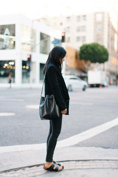 all black outfit leather bag and birkenstock sandals style minimal