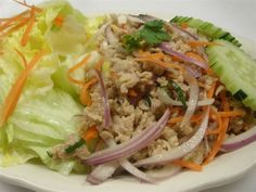 Larb :Ground Chicken or Beef mixed with spicy lime dressing, onion, carrot, roasted rice, and lettuce. #chicken #Noodles #meat #vegetables #Awesome Thai #Food forked.com