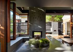 Local House by MAKE Architecture. Concrete has been formed up insitu using recycled fence palings to give texture & grain. Concrete is also used internally to create integrated seats, benches & durable surfaces for family life.