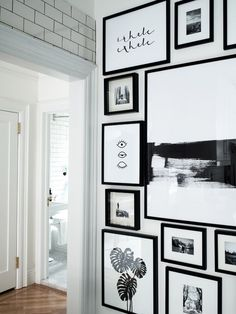 Monochrome gallery wall in Brooklyn home