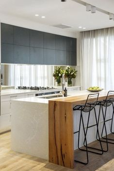 There is no question that designing a new kitchen layout for a large kitchen is much easier than for a small kitchen. A large kitchen provides a designer with adequate space to incorporate many convenient kitchen accessories such as wall ovens, raised. Modern Kitchen Island, Kitchen Benches, Modern Kitchen Design, Interior Design Kitchen, Timber Kitchen, Kitchen With Island Bench, Design Kitchen Island, Kitchen Layout, Kitchen Island Extension Ideas