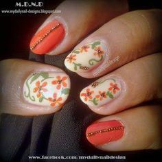 Connect smaller floral designs on your nails with looping stems and leaves—and finish off the solid nails with a column of gems!   - MarieClaire.com