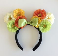 Celebrate spring with the cutest DIY floral Minnie Mouse ears! | [ http://blogs.disney.com/disney-style/lifestyle/2014/06/01/diy-floral-minnie-ears/ ]