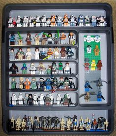 Lego Minifigure Display case made from a silverware drawer organizer for less than $20. My son LOVES it!