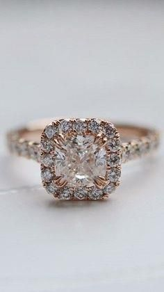 cool round diamond in a square halo. i think i like this better than a round halo. since it is different.