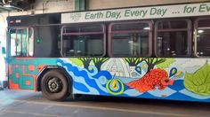 Streetside View of Bus Mural I designed for Metro Bus. Client: Earth Day 2015. Sponsored by Project Clear STL (MSD)