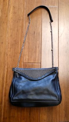 Christian Louboutin black leather purse with studded handle, $699 + find much more at www.thexchangeclothing.com