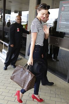 Miranda toting the classic Louis Vuitton Damier Speedy