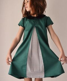 The Eleena dress is a 1960s inspired A-line dress that features an inverted pleat and an invisible zipper in the back. There are three sleeve...