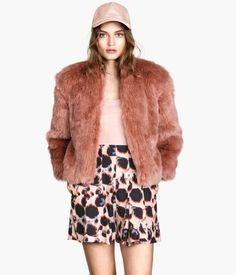 Faux fur jacket with side pockets. Concealed hook-and-eye fastener at front. Satin lining.  http://foxyblu.com/details/127049