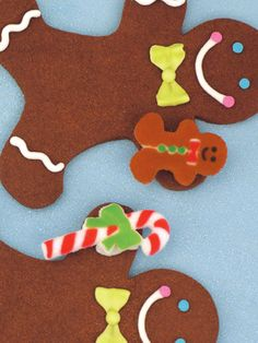 Candy Gingerbread Men featuring Lucks Gingerbread Man and Candy Cane Assortment Dec-Ons® decorations.