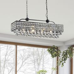 Light up your home with this Jolie Antique Black 5-light Rectangular Crystal Chandelier. This 5 -light chandelier is made of crystal and iron and features a black finish that will enhance the decor st...