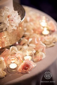 Candles, roses and rose petals make for romantic cake table decor