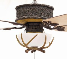 Love this....rustic ceiling fan w/antler light fixture for great