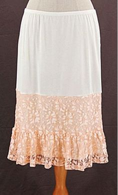 """Solid skirt extender slip with elastic waistband and contrast colored floral lace trim. Add length to your favorite skirt or dress! About 24"""" long."""