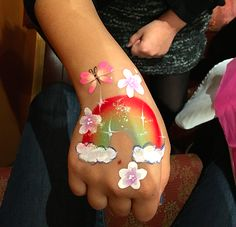 A rainbow and clouds with a butterfly face painting design painted on a child's hand. Homemade Face Paints, Homemade Paint, Face Painting Tutorials, Face Painting Designs, Easy Halloween Face Painting, Scary Halloween, Halloween Makeup, Halloween Costumes, Rainbow Face Paint