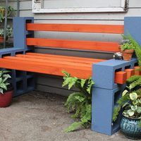 Build a simple outdoor bench with concrete cinder blocks and 4x4 wood posts.  You'd be surprised how sophisticated these basic materials can look!