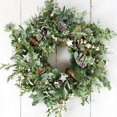 How to: create a Christmas wreath - The White Company Journal Guaranteed to create a warm welcome, acclaimed florist Philippa Craddock shares her step-by-step guide to handcrafting a beautiful festive wreath. Christmas Wreaths For Windows, Homemade Christmas Wreaths, Homemade Wreaths, Xmas Wreaths, Christmas Diy, Christmas Decorations, Holiday Decor, Christmas Swags, Rustic Christmas