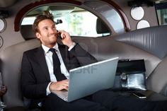 http://www.123rf.com/photo_12063398_smiling-handsome-businessman-sitting-in-luxury-limousine-working-on-laptop-computer-smiling.html