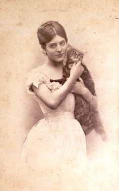 I think it's great that in a time when photos were scarce this woman chose to be posed with her cat. She's got her priorities straight.