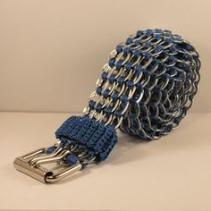 """Belt made from soda can pull-tabs.  There are instructions for making these (and also bracelets) on various websites and YouTube.  This one was made by the blogger """"Tabsolute"""".  I like the color of this one; it would be perfect to wear with jeans."""